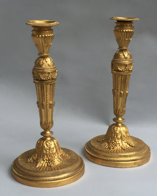 Pair neoclassical ormolu flambeaux by Unknown Artist