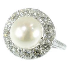 Diamond and pearl platinum estate engagement ring by Unknown