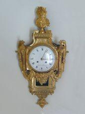 A very fine gilt bronze cartel clock, d'époque Louis XVI , mascaron, by Gérard à Ste Menehould, Fran