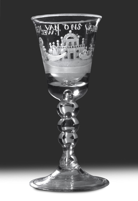 """A GLASS WITH THE ENGRAVING OF A COUNTRYSIDE WITH FARMERS, HERDSMEN AND AN EAST-INDIAMAN IN THE BACKGROUND, WITH TEXT """"HET LANDS WELVAREN"""" by Unknown Artist"""