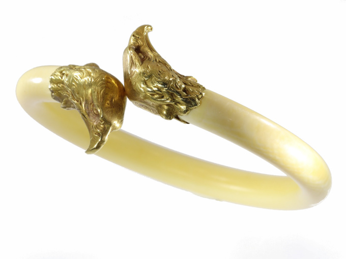 French Late Victorian antique ivory bangle with big gold eagle head ornaments by Unknown Artist
