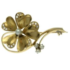 Victorian gold flower brooch antique jewelry with rose cut diamonds and pearls by Unknown Artist