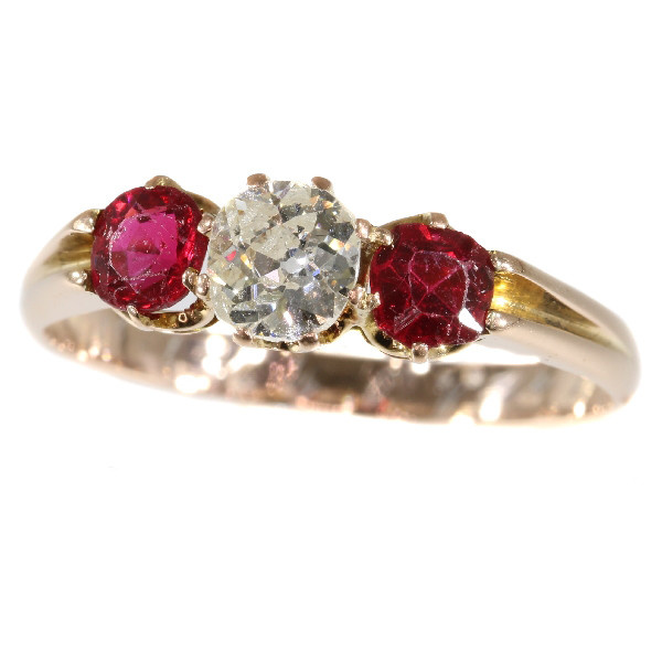 Antique ring with old mine brilliant cut diamond and two red strass stones by Unknown Artist