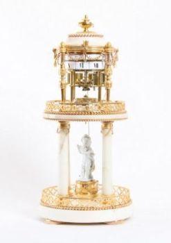 A French Louis XVI ormolu and marble cercles tournants mantel clock, Gille A Paris, circa 1775 by Gille A Paris