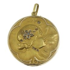 Art Nouveau pendant locket with ladies face and set with rose cut diamonds by Unknown Artist