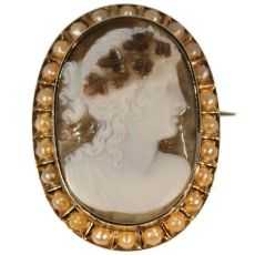 Antique chalcedony agate cameo in gold mounting with half seed pearls by Unknown