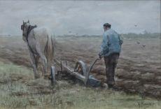 A plowing farmer