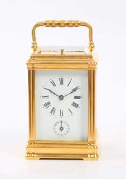 A fine French gilt brass Gorge case repeating alarm carriage clock, circa 1880. by Unknown Artist