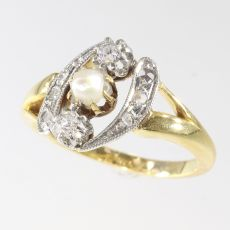 Elegant estate diamond and pearl engagement ring by Unknown Artist