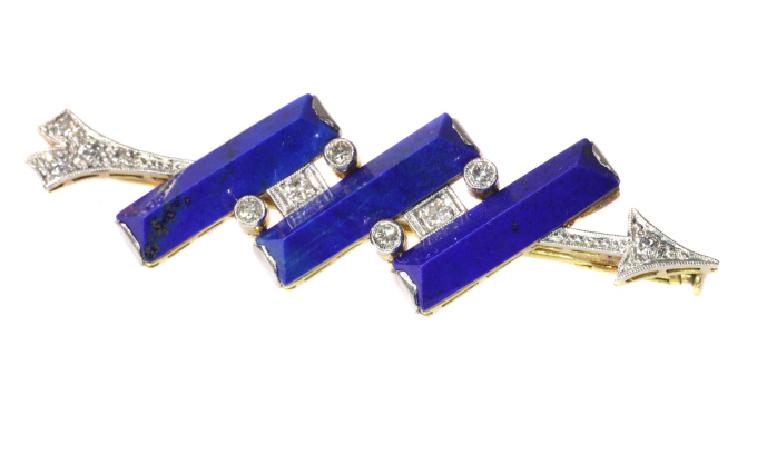 Diamond arrow brooch perforating three solid bars of lapis lazuli by Unknown
