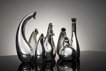 """kannenkoor""  (jugs choir) set of 8 jugs by Paul de Vries"