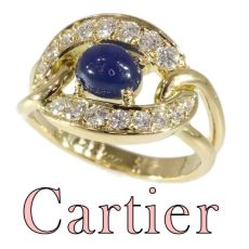 Vintage luxury CARTIER ring with sapphire and diamonds by Cartier